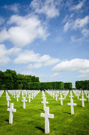 White cemetery against sky