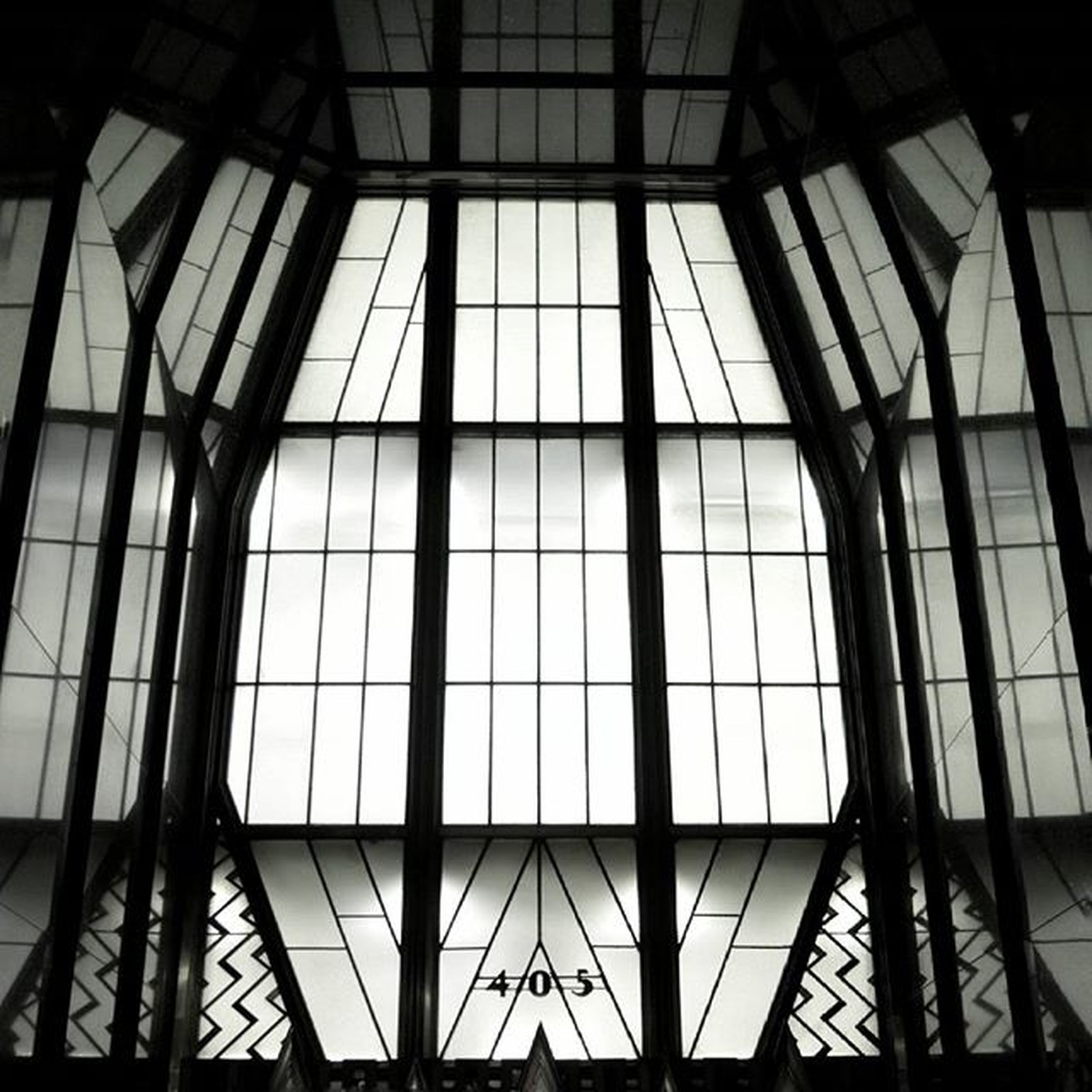 indoors, architecture, glass - material, built structure, ceiling, low angle view, window, pattern, skylight, transparent, modern, architectural feature, geometric shape, full frame, backgrounds, no people, design, building, glass, reflection