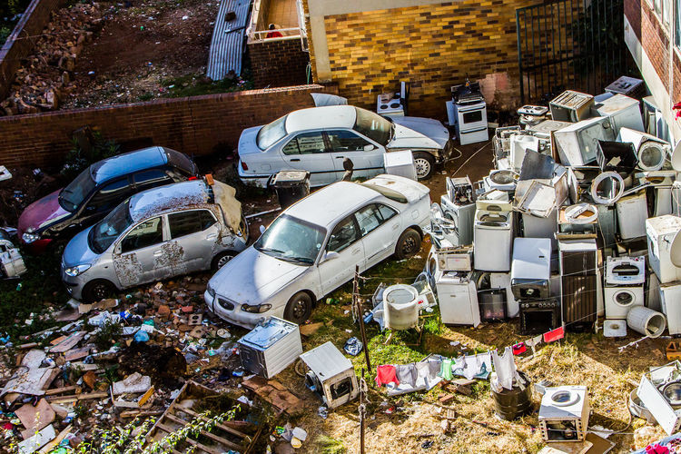 Junkyard No People Garbage High Angle View Damaged Motor Vehicle Car Obsolete Abandoned Stack Land Vehicle Large Group Of Objects Washing Machines Real People Yard