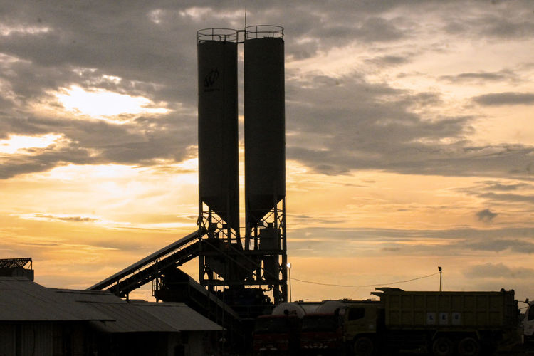Sunset Sky Architecture Cloud - Sky Built Structure Industry Building Exterior Business Finance And Industry Nature Factory No People Outdoors Fuel And Power Generation Silhouette Dramatic Sky Technology Dusk Low Angle View Tower Metal