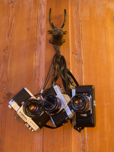 Analog Camera Analogue Photography Antique Arts Culture And Entertainment Camera - Photographic Equipment Close-up Day Film Camera Film Cameras Hanging No People Old-fashioned Retro Styled Technology Wooden Background