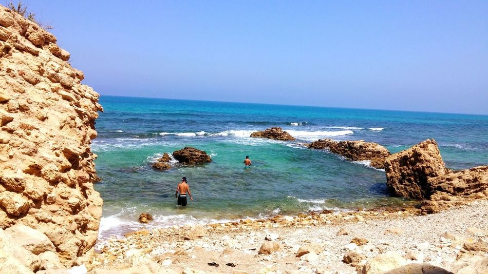 Sea Beach Rock - Object Clear Sky Real People Water Sunlight Day Outdoors Nature Beauty In Nature Wave People Adult Isreal