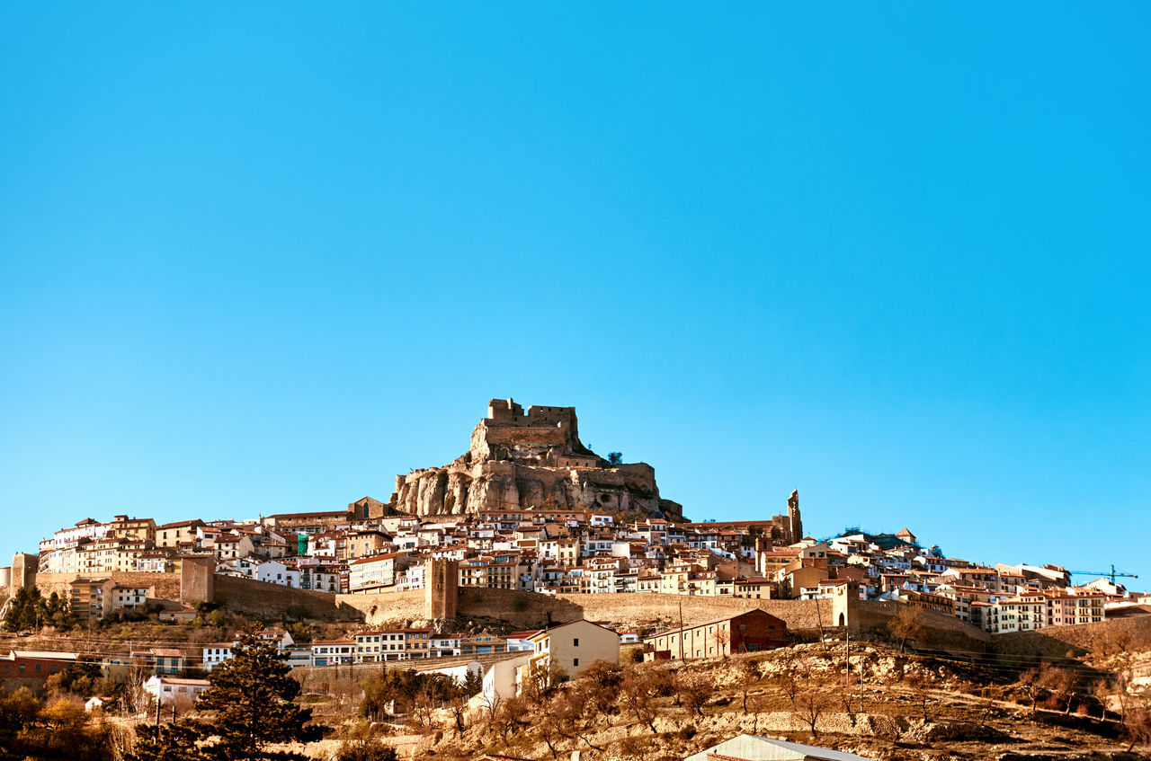 Morella skyline. Morella is an ancient gothic city located on a hill-top in the province of Castellon, Valencian Community, Spain. Morella is in the heart of the historic region of Meastrazgo, and it is listed as one of the most beautiful towns in Spain Ancient Architecture Blue Sky Castellón Europe Fortification Gothic Architecture Hillside Hilltop History Landmark Landscape Maestrazgo Medieval Castle Monument Morella Old Town Picturesque Village Scenery Skyline SPAIN Sunny Day Travel Destinations Valley Village Walled Castles