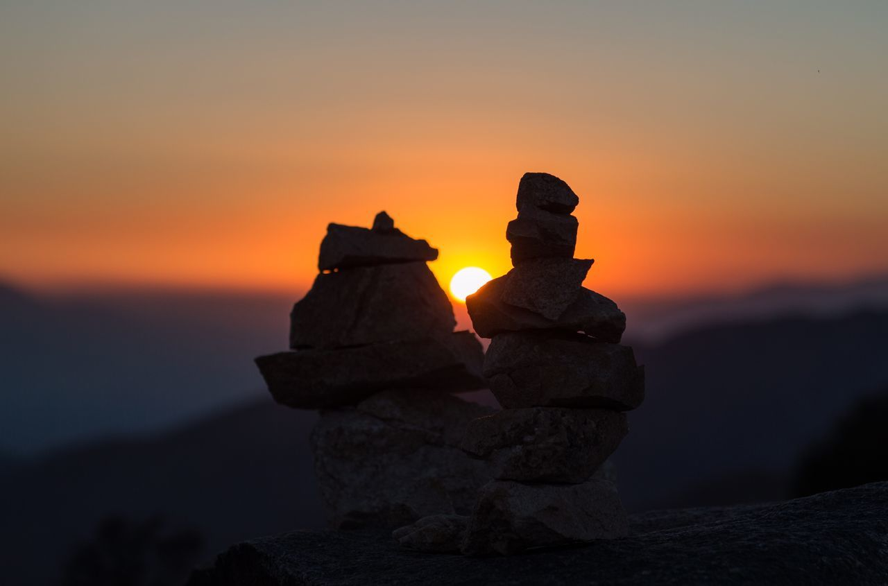 sunset, orange color, stack, no people, rock - object, nature, outdoors, sky, focus on foreground, sculpture, statue, scenics, beauty in nature, water, close-up, day