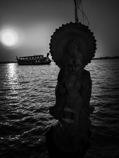 Statue of sea against sky