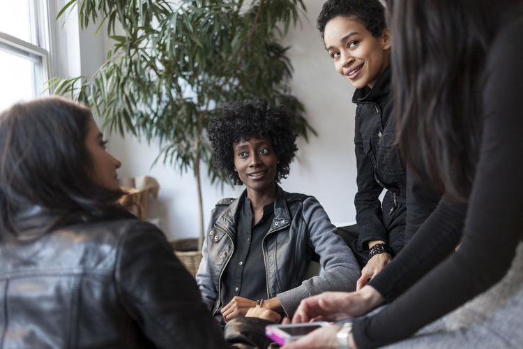 Young women talking in an office
