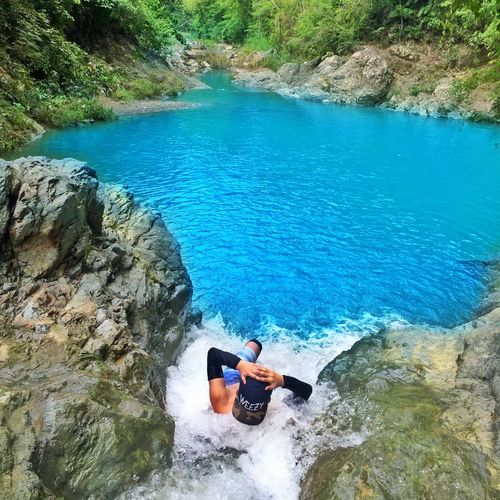 High angle view of two people in water