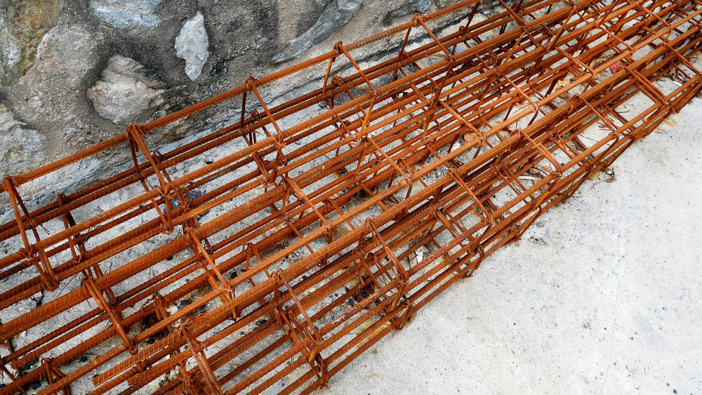 Rusty Rods and Wires of Reinforced Construction Concrete Column Construction Construction Site Industry Architecture Close-up Day Engineering Iron - Metal Metal No People Outdoors Reinforcement Bar Rusty Steel
