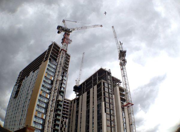 Building site with cranes Crane Construction Site Building Site Skyscrapers London Airplane
