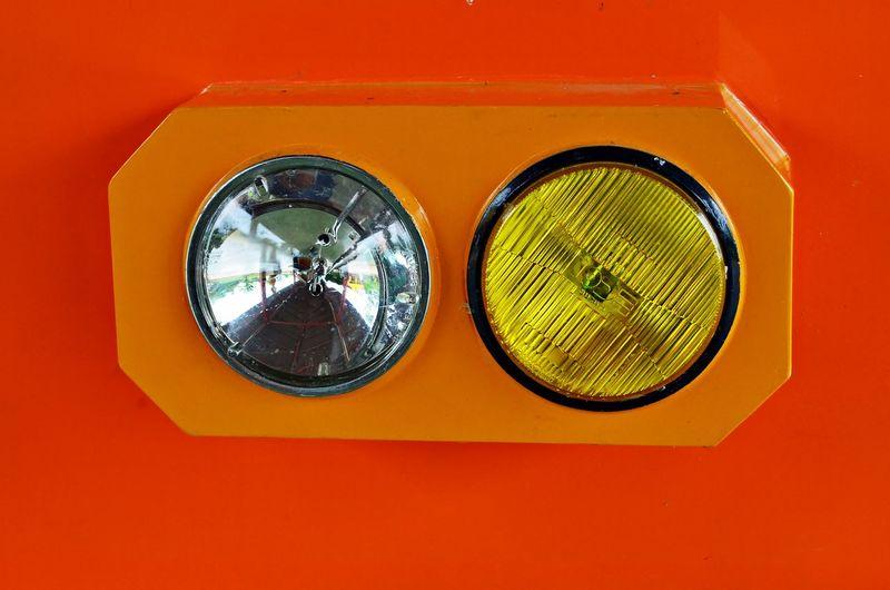 Close-Up Of Lighting Equipment On Orange Wall