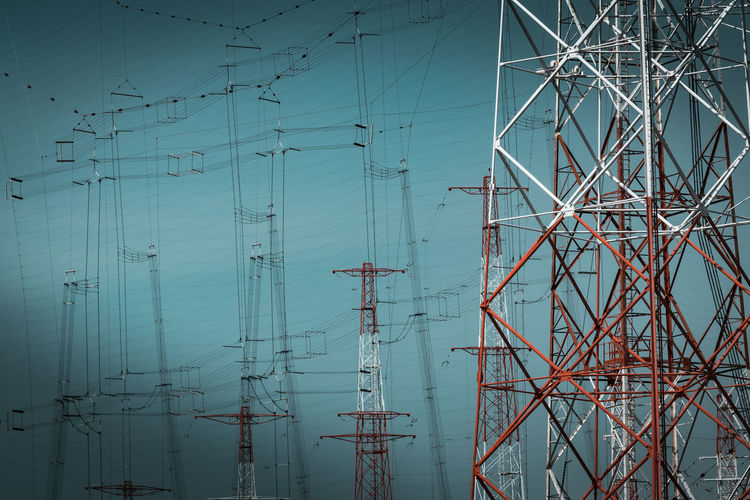 Close-up of electricity pylons against clear sky
