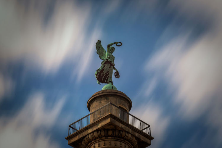 Waterloosäule in Hannover Sculpture Statue Representation Art And Craft Low Angle View Sky Human Representation No People Cloud - Sky Architecture Creativity Day Built Structure Female Likeness History The Past Craft Male Likeness Angel Pillar Monument EyeEm Best Shots Hannover Long Exposure Clouds