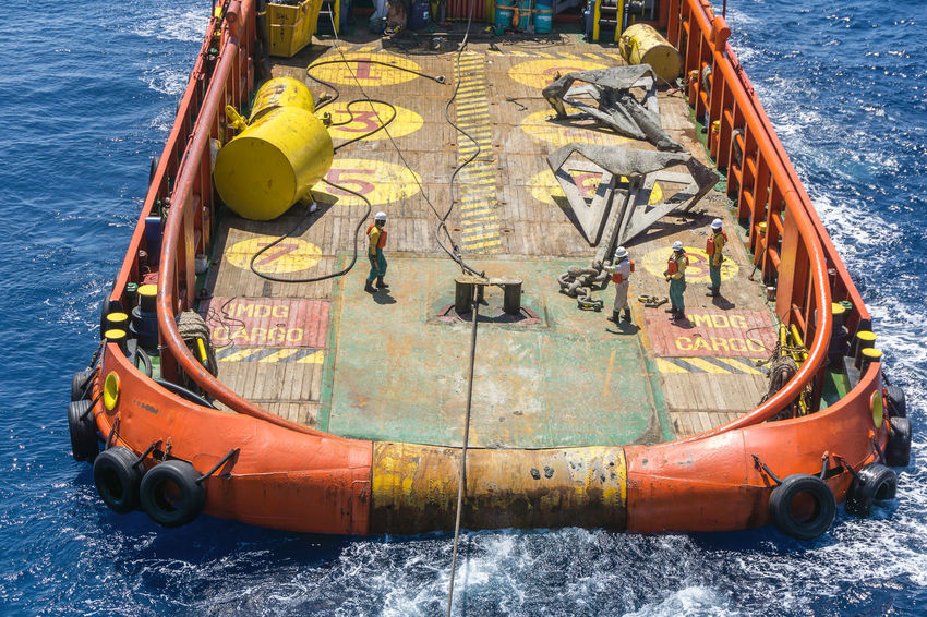 anchor handling job Coverall PPE Oil Field Wave Rippled Stern Roller Anchor Buoy Deck Anchor Handling Tug Vessel Tugboat Tug Boat Vessel Able Bodied Seaman Offshore Offshore Life Safety Rigging Water Nautical Vessel High Angle View Close-up Boat Anchor - Vessel Part