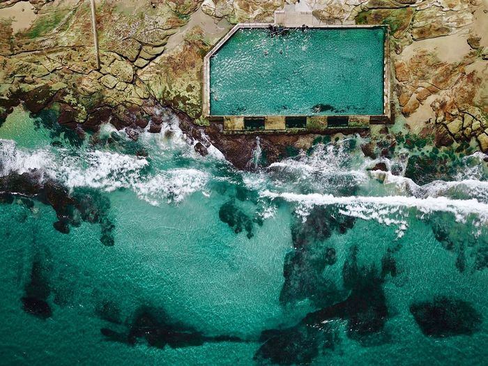 Aerial view of swimming pool by sea
