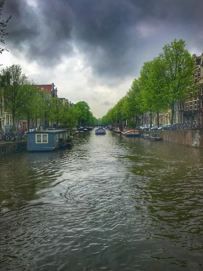 Typical Moody Amsterdam Canal Scene Netherlands Amsterdam Water Cloud - Sky Tree Sky Plant Nautical Vessel Transportation Architecture Mode Of Transportation Waterfront Built Structure Building Exterior River Moored Day