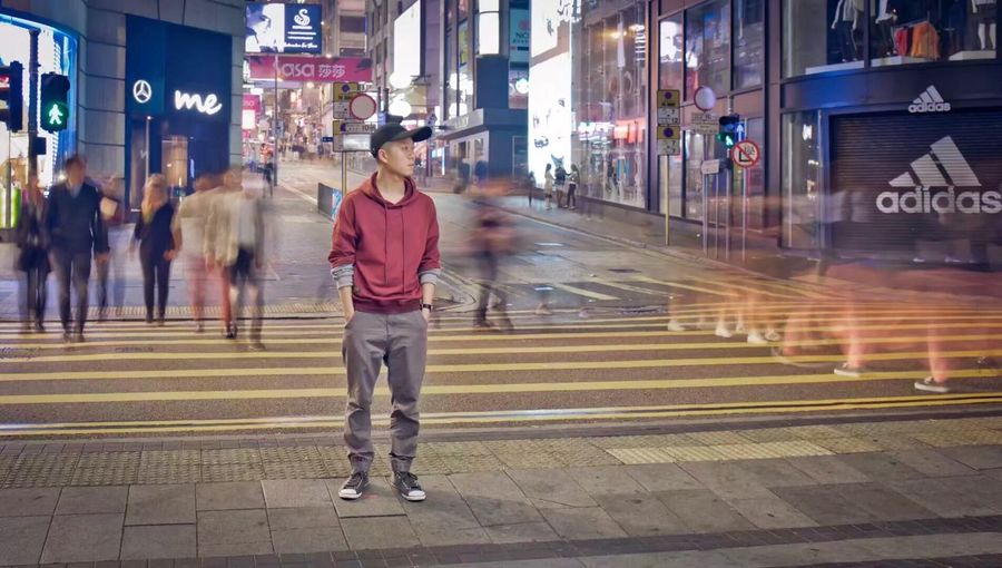 Full length of man on illuminated city at night