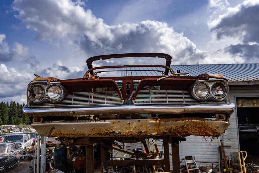 Abandoned Car Cloud - Sky Damaged Day Decline Deterioration Junkyard Land Vehicle Metal Mode Of Transportation Motor Vehicle No People Obsolete Old Outdoors Retro Styled Ruined Run-down Rusty Sky Transportation Vintage Car