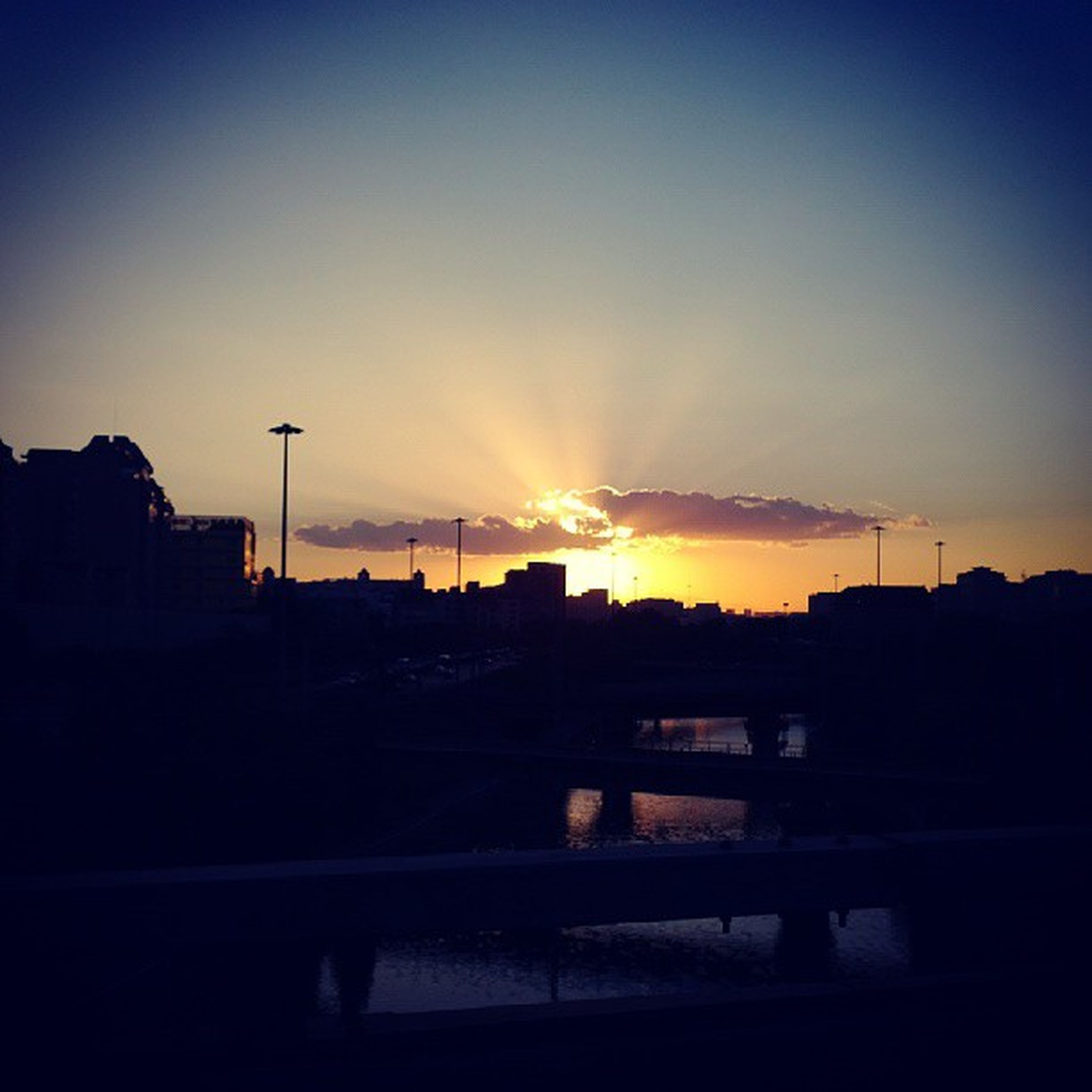 sunset, silhouette, building exterior, built structure, sky, architecture, orange color, city, sun, dark, street light, copy space, electricity pylon, sunlight, scenics, power line, beauty in nature, nature, dusk, outdoors