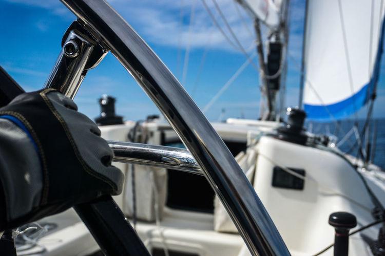 Close-up of ship sailing on sea