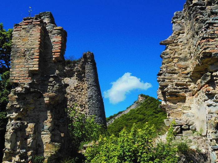Ancient Ancient Civilization Architecture Beauty In Nature Blue Day Georgia History Low Angle View Mountain Nature No People Old Old Buildings Old Ruin Outdoors Sky