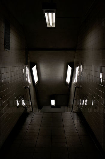 Interior of illuminated empty walkway