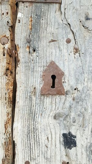 Keyhole Lock Close-up Textured  Outdoors No People Day Wood Key Secret Neutral Colours Splinters Door Closed White Natural Architecture Old Weathered Mystery Hidden Hide Locked Wood Natural Tones