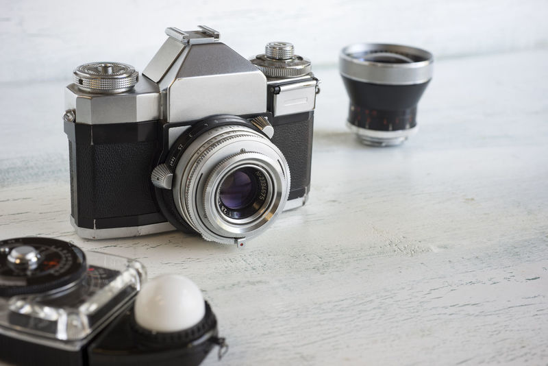 Retro camera gear Accessories Camera - Photographic Equipment Close-up Equipment Film Camera Horizontal Composition Lens Light Meter Metal No People Photography Retro Styled Selective Focus Silver  Single Lens Reflex Still Life Vintage Wood Surface