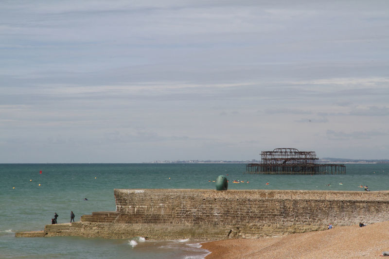 Beach Brighton Brighton Pier Built Structure Burnt Building Burnt Pier Cloud - Sky Day England Horizon Over Water Outdoors Sculpture Sea Shingle Beach Sky The Channel United Kingdom Vacations Water Waterfront Waves