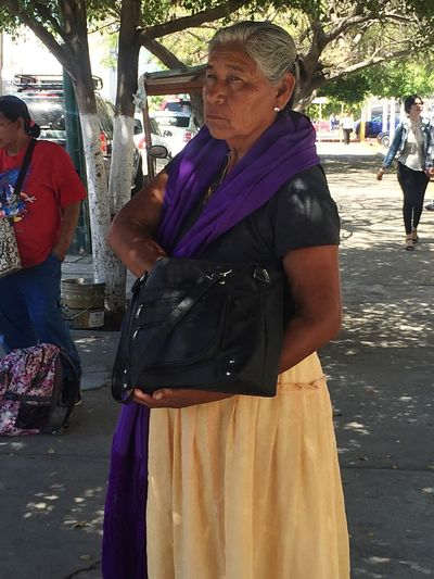 Waiting on the public transportation Lady On A Bus Stop Public Transportation Woman Outdoors Real People Senior Adult Men Day Traditional Clothing Senior Men People Adult Adults Only