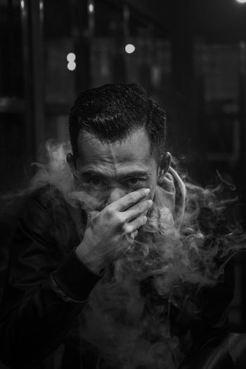breath Blackandwhite Smoke - Physical Structure Portrait One Person Adult Men Headshot Leisure Activity Smoking - Activity Lifestyles Social Issues Real People Depression - Sadness Human Face Front View Mid Adult Men Smoking Issues