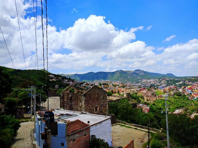 The best clouds are in Mexico Clouds Mexico Cloud - Sky Sky No People Tree Outdoors Mountain Architecture Nature Day City History Building Exterior Sunlight Earth Morelia Bright Vibrant The Great Outdoors - 2017 EyeEm Awards Adventures In The City
