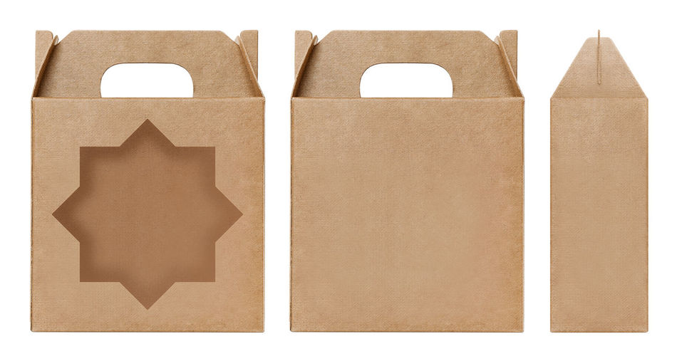 Close-up of various paper bags against white background