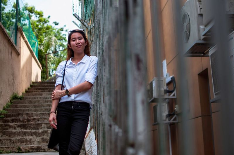 The Portraitist - 2016 EyeEm Awards Portrait Standing Singapore Portraits Portrait Of A Woman Outdoors Front View Casual Clothing Built Structure Building Architecture