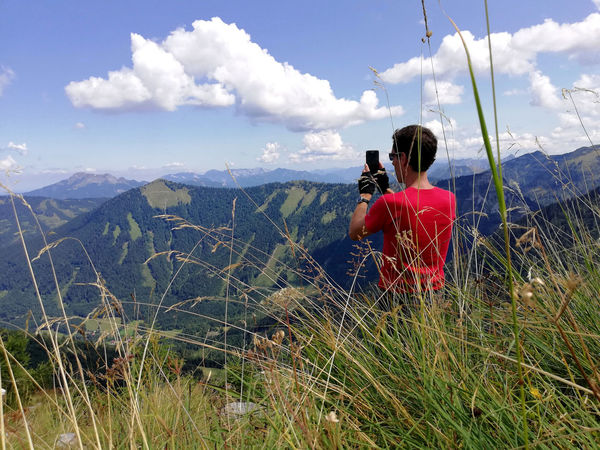 Austrian Alps Beauty In Nature Cloud - Sky Landscape Leisure Activity Looking At View Mountain Mountain Range Nature Non-urban Scene One Person Photographer Photographing Photography Themes Rear View Scenics - Nature Sky Technology Wireless Technology