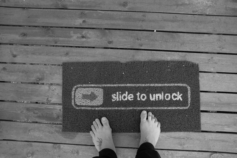 Slide to unlock Apple Fan Doormat Low Section Body Part Real People Human Leg Human Body Part One Person Personal Perspective