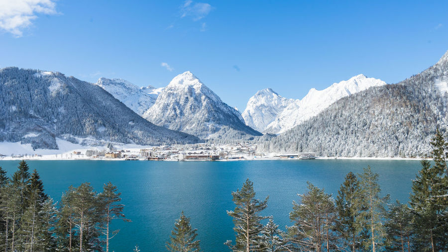 Achensee Hotels Mountain View Tirol  Achenkirch Beauty In Nature Blue Blue Sky Cold Temperature Day Lake Lake View Mountain Mountain Range Nature No People Outdoors Scenics Sky Snow Snowcapped Mountain Tranquil Scene Tranquility Villa Water