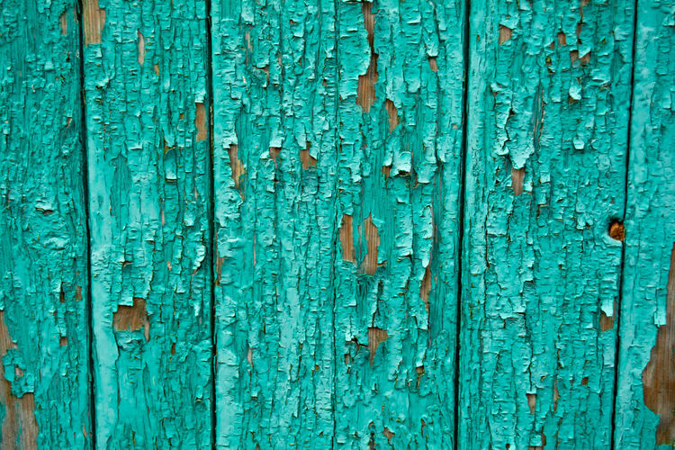 The texture of the painted wooden boards. background from old boards of green color.