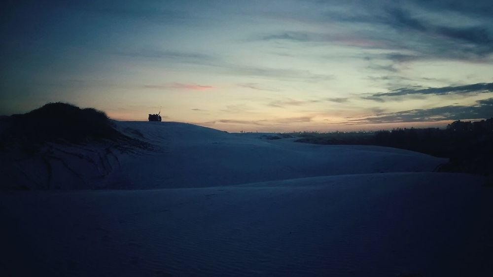 Is it snow or sand? (: Snow Winter Cold Temperature Sunset Mountain Landscape Beauty In Nature Dramatic Sky Outdoors Scenics People Only Men One Person Adults Only Adult Nature Day One Man Only Snowboarding Sand Dunes Sand Dune Beach Photography Miles Away