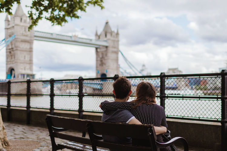 Iconic monuments and moments. Two People Architecture Women Real People Rear View Sitting Built Structure Adult Togetherness Lifestyles Bench Connection Leisure Activity Men Love Sky Seat Couple - Relationship Positive Emotion Nature Bridge - Man Made Structure Outdoors Ann Ilagan Photography London Tower Bridge