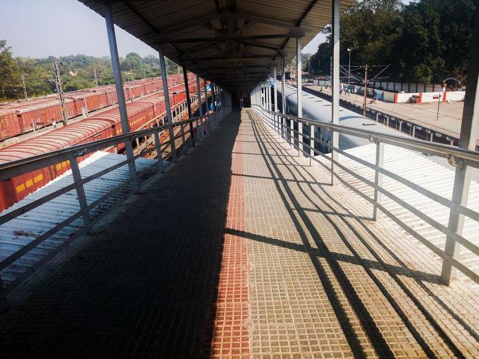 Shadow Bridge - Man Made Structure Sunlight Built Structure Transportation Architecture Tree Outdoors Day No People Sky Rail Transportation Train - Vehicle Railroad Station Platform Locomotive Jharsuguda Odisha India