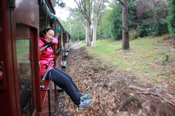 The best way to enjoy the Puffing Billy train ride is by sitting on the carriage's window ledge and with legs dangling out. Australia Be. Ready. DandenongRanges Melbourne Australia Puffing Billy Railway Victoria Australia Australia & Travel Dandenong Ranges Travel Destinations