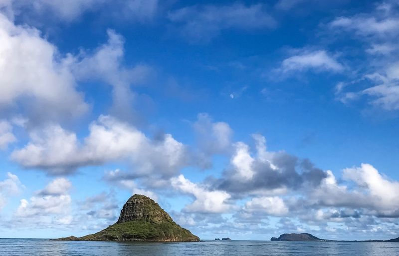 Chinaman's Hat and Moon Oahu Hawaii Myth Chinaman's Hat Blue Sky And Clouds Moon Sea Sky Cloud - Sky Beauty In Nature Nature Tranquility Tranquil Scene Scenics Blue Water Horizon Over Water No People Day Outdoors