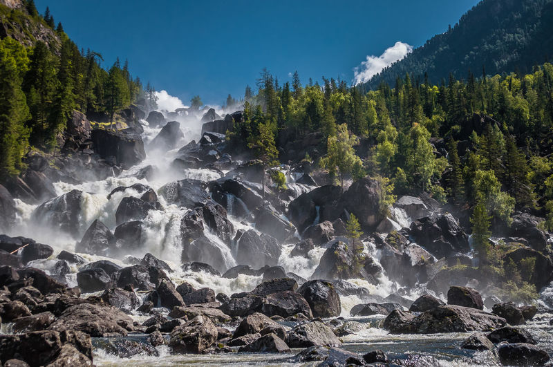 Beauty In Nature Blurred Motion Flowing Flowing Water Forest Land Long Exposure Motion Mountain Nature No People Non-urban Scene Outdoors Plant Power In Nature Rock Rock - Object Scenics - Nature Sky Solid Tree Water
