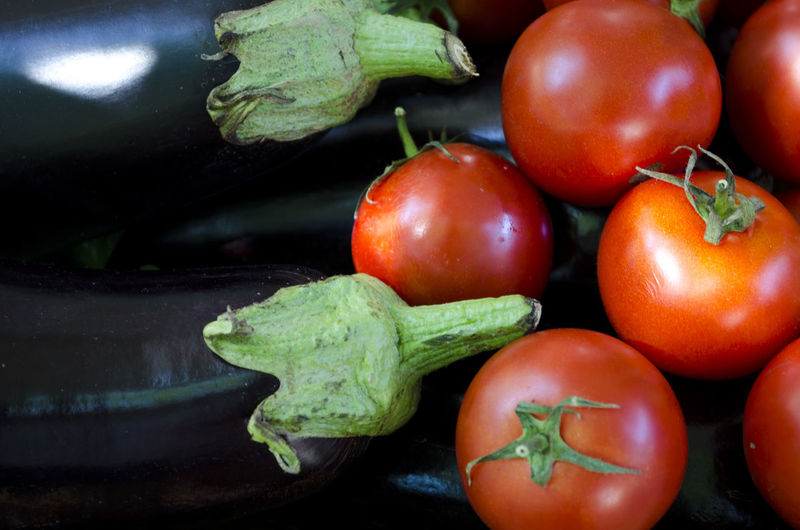 Close-Up Of Tomatoes And Eggplants