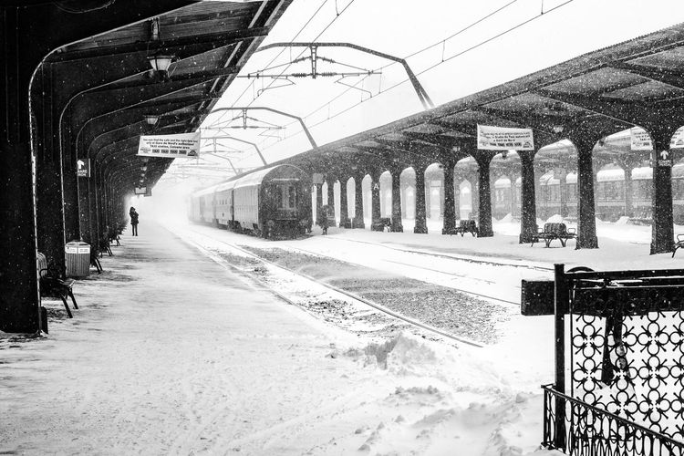 Alone Alone In The City  Alone In The Station Black And White Blackandwhite Photography Composition Diminishing Perspective EyeEm Best Shots Narrow One Person Platform Railway Railway Station Snow Day Snow ❄ Street The Week Of Eyeem Train Station Train Station Winter Train Tracks Transportation Winter Blizzard 2016 The Street Photographer - 2016 EyeEm Awards Shades Of Winter