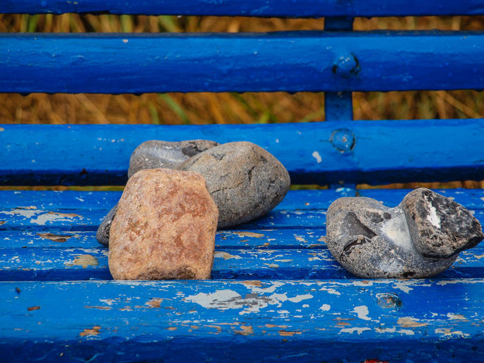 Blue Wood - Material Close-up No People Metal Solid Day Stone - Object Rock Outdoors Nature Textured  High Angle View Full Frame Bench Rock - Object Strength Seat Still Life