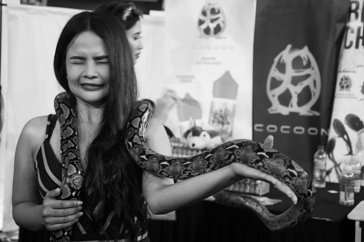 Fear Streetphotography Blackandwhite Peoplephotography Monochrome Phython Snake One Person Indoors  People Adult One Woman Only Only Women Close-up
