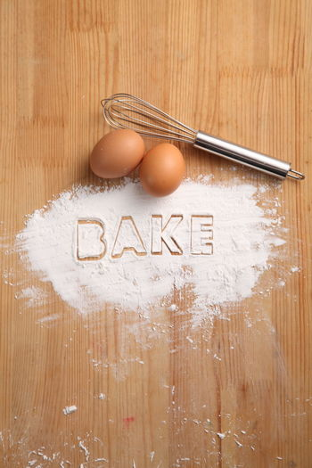 baking concept,hand whisk and eggs Food Food And Drink Egg Eggs Preparation  Flour Baking Bakery Homemade Ingredient Cooking Powder Pastry Healthy Eating Wood - Material Concept Recipe Hand Whisk Whisk Alphabet Still Life Table Brown Western Script No People