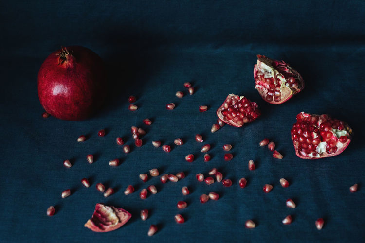 High angle view of apples on table against black background