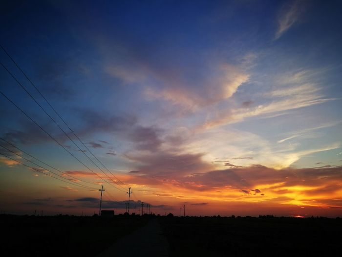 Sunset Sky Cloud - Sky Electricity  Silhouette Electricity Pylon Cable Power Line  Beauty In Nature Landscape Scenics - Nature Power Supply Orange Color Fuel And Power Generation Environment Technology No People Nature Tranquil Scene Tranquility Outdoors Telephone Line